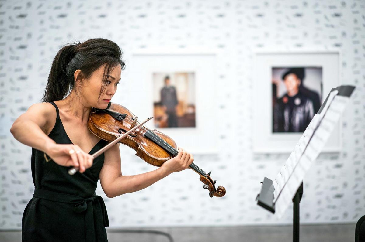 Art of Elan is a non-profit that brings classical music to diverse audiences in San Diego. A violinist performs during a 2019 Art of Elan concert.