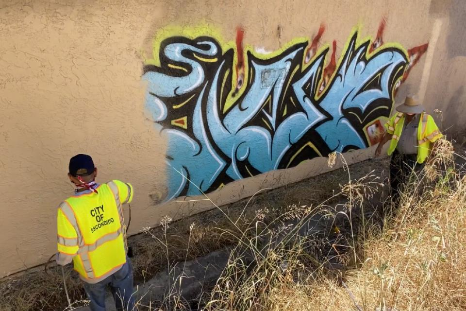 City of Escondido public works employees remove graffiti.